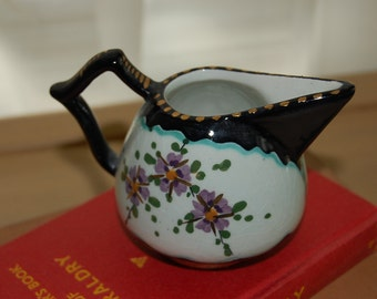 Little pitcher, black, purple, gold, 177