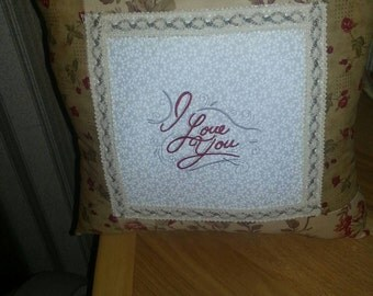 Decorative pillow that says I love you.