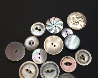 Lot of 13 abolone vintage buttons.  All types.