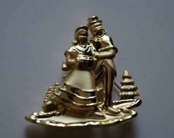 Vintage 1970s AJC Gold Tone Figural Ice Skaters Pin Or Brooch Winter Outdoor Scene