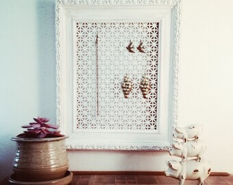 Vintage picture frame jewelry display in antique white