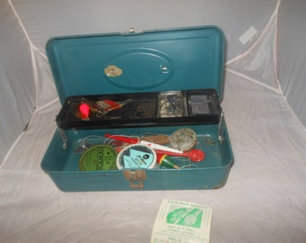 Vintage tackle box with lures and fishing accessories,dark green metal tackle box,union model 2311,vintage lures,line, and tackle included