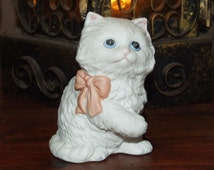 Vintage Porcelain Blue Eyed Scruffy Fluffy White Sitting Kitty Cat with Pink Bow Statue Figurine
