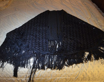 A Vintage Black Shawl With Long Fringe and Sequins