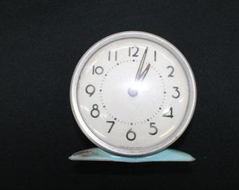 vintage blue metal alarm clock