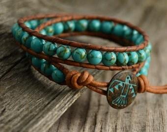 Turquoise beaded leather wrap bracelet. Thunderbird boho chic stack bracelet