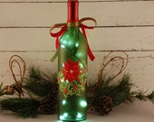Christmas lights, hand painted wine bottle lamp, poinsettia and holly