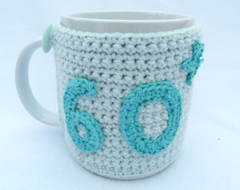 60th Birthday light turquoise crochet mug cozy with turquoise applique numbers