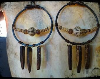 Hammered metal wire, hoop earring's and wood spike dangles.
