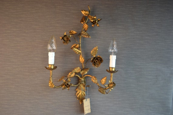 Large golden Italian tole sconce with metal roses around 1940
