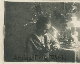 Young woman scientist with microscope and skull antique rppc photo