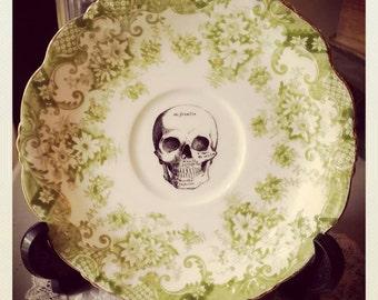 Vintage saucer with skull design decal