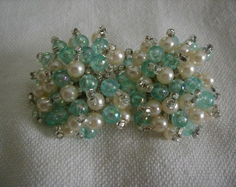 Wonderful pearl and bead clip earrings.   The color is perfect for spring and summer.