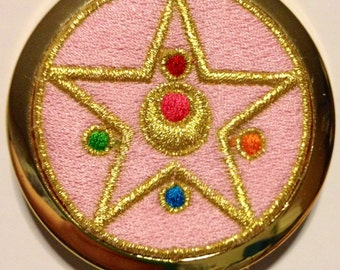 Sailor Moon Transformation Compact Inspired Metallic Gold Embroidered Compact Pocket Mirror With A Bright Gold Finish With Dual Mirrors