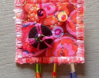 Quilted pin, Quilt Art, fabric art, colorful