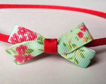Red and green floral bow metal headband