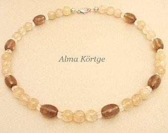 Chain necklace of rutilated quartz rock crystal smoky quartz