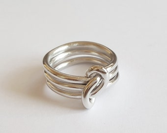 triple knotted ring