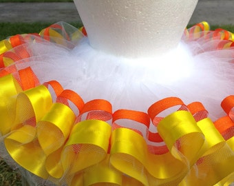 Candy corn white tulle tutu with orange and yellow ribbon trim.