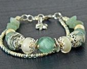 Roman bracelet with Seafoam green and Beige Lampwork, Ghana beads, Green aventurine, Lampwork bracelet, Green glass bead bracelet, OOAK