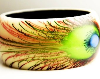 Vintage wide bangle bracelet with amazing ostrich feather design. Brilliant blues, greens and salmon colored details