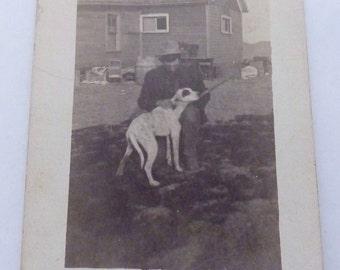 1910 RPPC Real Photo Postcard South Dakota Man Rifle Gun Bird Dog Farm 21690