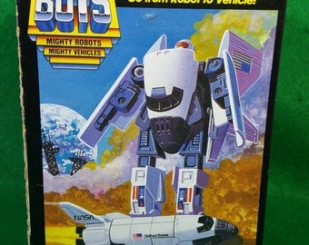 Vintage Tonka Super GOBOTS Spay-C friendly robot space shuttle with original box.
