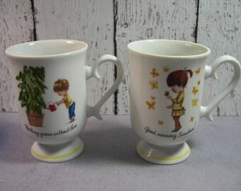 Moppets pedestal mugs by Fran Mar 1975 Porcelain made in Japan