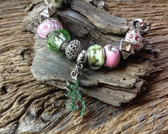 Pink and green Browning bracelet: pink and green deer head charm beaded bracelet