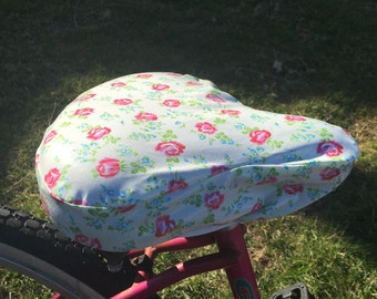 Premium Laminated cotton, waterproof cruiser bike seat cover in pink and white floral design fabric