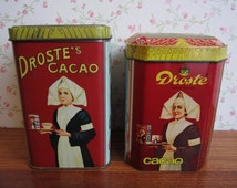 Two Vintage Droste's Cacao Tin Nurse Dutch Cocoa Container Canister Storage Drinking Hot Chocolate The Netherlands Holland Haarlem Red Black