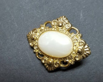 Gold buttons with pearl centers. Shank type
