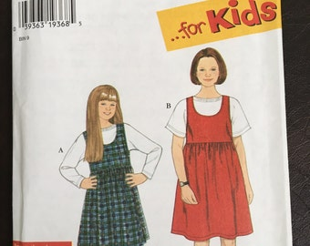 Simplicity pattern 7323, girls' jumper and knit top, sizes 7,8,10,12,14, new, incut,  English, French, Spanish