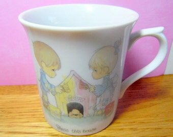 1982 Jonathan & David, Enesco, Precious Moments coffee cup.