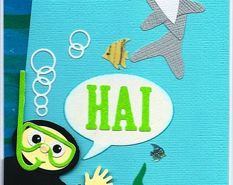 "A ""Hai"" greeting card with diver and shark"
