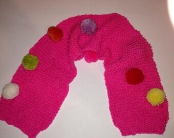 Childs pretty handknitted pom pom scarf, multiciloured.
