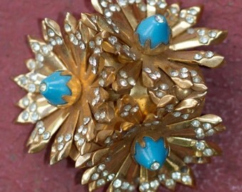 Metal flower brooch