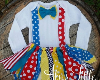 3 piece Circus or Clown themed tutu set comes with onesie, fabric tutu skirt and bow on headband or clip