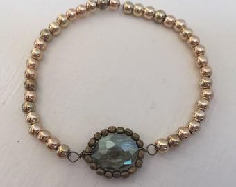 Jade and gold beaded bracelet