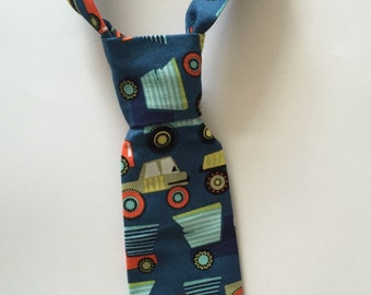 Baby Boy/ Toddler Dump Truck Tie.  It will fit a baby to a 2 year old.