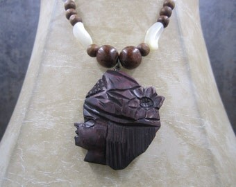 Stunning Mother of Pearl and wood necklace with carved wood pendant