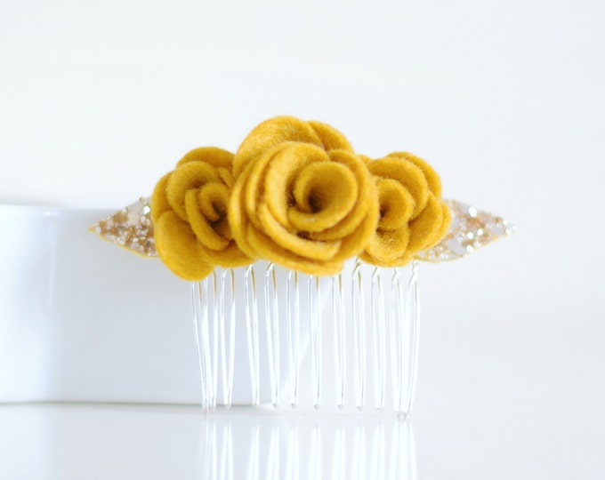 Featured listing image: A mustard flower hair accessory that is loved by brides and bridesmaids as a finishing touch to the wedding accessories