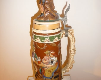 Large German Bavarian polychrome pottery stein with hunting scenes - circa 1920