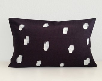 Cushion cover with a white pattern, dark grey