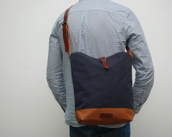 Messenger  bag waxed canvas,navy blue color, closures in leather
