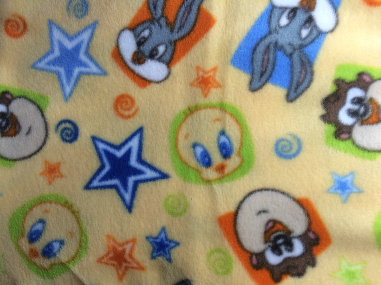 Fabric by the 1 2 yard baby loony toons anti pill fleece for Baby fabric by the yard