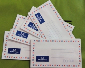 "Set of 10 vintage airmail envelopes with plane border - 6.3"" x 3.6"""