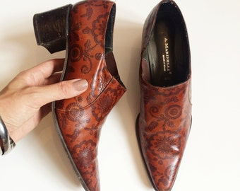 Brown leather patterned ankle boots with stacked heel. Size 8.