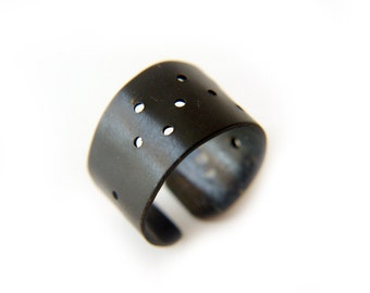 punk ring, black band ring with drilled holes