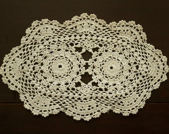 Vintage oval cream doily